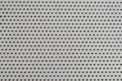 Laptop Speaker Hole grid metallic pattern macro with dust inside Royalty Free Stock Photos