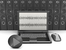 Laptop on speakers background Royalty Free Stock Photo