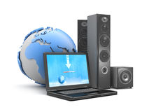 Laptop, speakers and earth globe Stock Photo