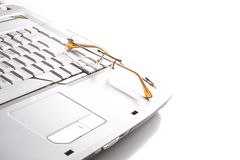 Laptop and spectacles Royalty Free Stock Photography