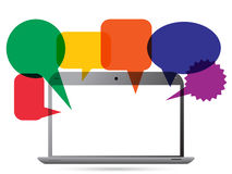 Laptop with speech bubbles stock images