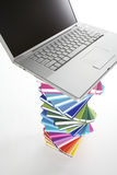 Laptop on spiral book stack, top view Stock Images