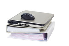 Laptop on a stack of file folders. Stock Photos
