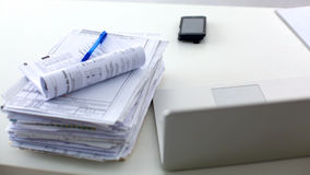 Laptop with stack of folders on table on white Royalty Free Stock Photos
