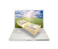Laptop with Stack of Money Coming From Screen Stock Photo