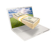 Laptop with Stack of Money Coming From Screen Royalty Free Stock Photo