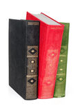 Laptop and a stack of old books. On white background Royalty Free Stock Photo