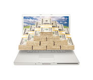 Laptop with Stacks of Money Coming From Screen Stock Photo