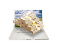Laptop with Stacks of Money Coming From Screen Stock Photography