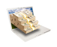 Laptop with Stacks of Money Coming From Screen Royalty Free Stock Images
