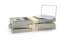 Laptop stand on pack of dollars Royalty Free Stock Photo