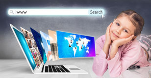 Laptop stands on the floor. Laptop with many screens stand on the floor and child beside Royalty Free Stock Photo