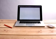 Laptop stands on a wooden table stock photos