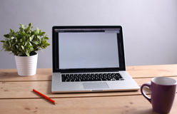 Laptop stands on a wooden table royalty free stock images