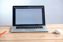 Laptop stands on a wooden table royalty free stock image