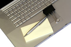 Laptop & Stationary. Silver Laptop, Pen, Post-It, Paper Clip Stock Photography