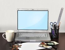 Laptop with stationery Royalty Free Stock Images