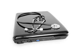 Laptop with stethoscope Royalty Free Stock Photos