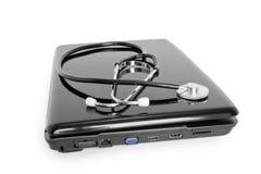 Laptop with stethoscope. Medicine technology;  laptop with stethoscope isolated on white Royalty Free Stock Photos