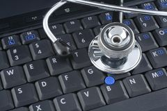 Laptop and stethoscope royalty free stock photo
