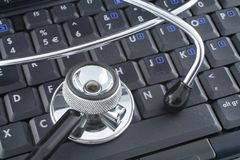 Laptop and stethoscope Stock Photography