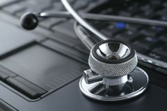 Laptop and stethoscope Royalty Free Stock Photos