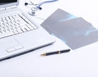 Laptop ,stethoscope and x-ray on the table. Photo with copy space Stock Photo