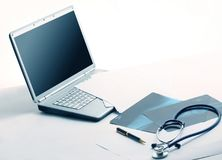 Laptop ,stethoscope and x-ray on the table. Photo with copy space Royalty Free Stock Photo