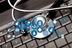 Modern laptop and stethoscope close-up view. Laptop stethoscope top computer background health brown Stock Photo