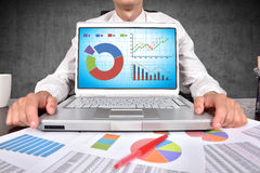 Laptop with stock chart on screen Stock Images