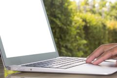 Laptop on stone table Royalty Free Stock Photography