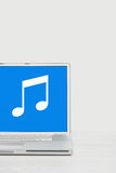 Laptop streaming music Stock Photos