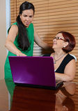 Laptop Success. Image of a younger lady and an older lady enjoying a laptop Stock Photo