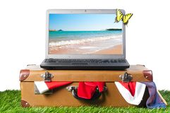 Laptop on suitcase Stock Image