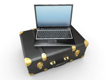 Laptop and suitcase Stock Photos