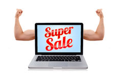 Laptop with super sale sign and muscular biceps Royalty Free Stock Photography
