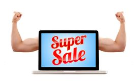 Laptop with super sale sign and muscular biceps Royalty Free Stock Photos
