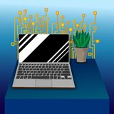 Laptop on tabel with Circuit board pattern. Blue and light blue bacground . plant on the tble Stock Photography