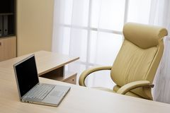 Laptop on a table Royalty Free Stock Photos