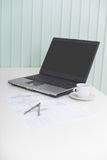 Laptop on table with drawing and a compasses Stock Photo