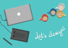 Laptop on the table with graphics tablet. Vector image with laptop on the table, graphics tablet and a lot of mugs Stock Photo