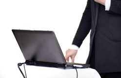 Laptop on table with hand Stock Photos