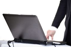 Laptop on table with hand Royalty Free Stock Photo
