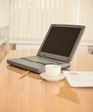 Laptop on a table at office Royalty Free Stock Photo