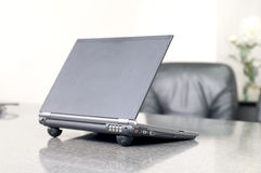 Laptop on table in office Royalty Free Stock Images