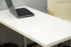 Laptop on the table. In the office. workplace of a doctor in a private clinic stock image