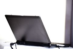 Laptop on a table with usb flash inside Stock Photography