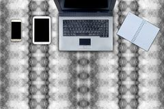 Laptop and table workspace office on abstract pattern.  Royalty Free Stock Photos