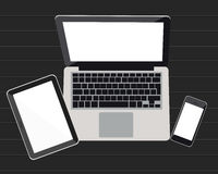 Laptop, tablet  on a background  dark wood Stock Image