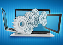 Laptop, tablet with gears. Repair and service of electronics. Teamwork Stock Photo